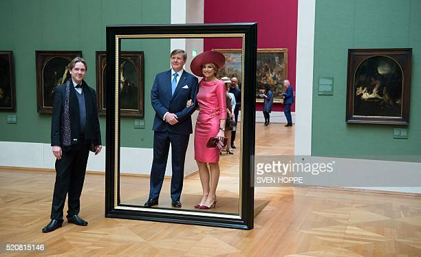 Queen Maxima and King WillemAlexander of the Netherlands pose in a giant picture frame as they tour through the 'HollaenderSaal' of the Alte...