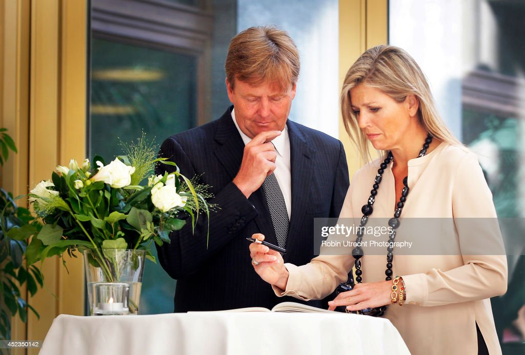 Queen Maxima and King Willem-Alexander of The Netherlands sign the book of condolence at the Ministry of Security and Justice for the victims of Malaysia Airlines flight MH17 on July 18, 2014 in the Hague, Netherlands. Malaysia Airlines flight MH17 was travelling from Amsterdam to Kuala Lumpur when it crashed killing all 298 on board including 80 children. The aircraft was allegedly shot down by a missile and investigations continue over the perpetrators of the attack.