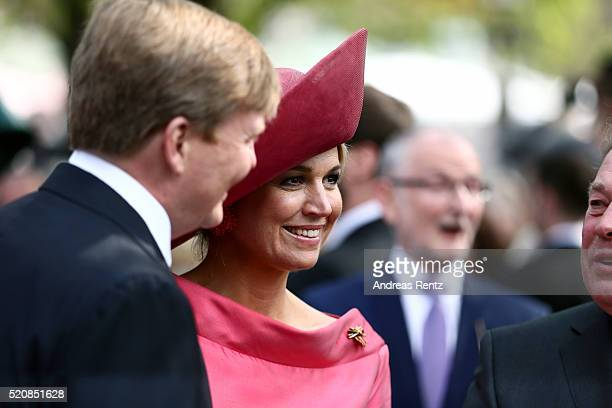 Queen Maxima and King WillemAlexander of the Netherlands visit the Viktualienmarkt on April 13 2016 in Munich Germany King WillemAlexander and Queen...