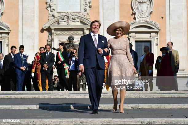 Queen Maxima of Netherlands and King WillemAlexander pose in front of Rome City Hall after a meeting with Rome's mayor Virginia Raggi on June 20 2017...