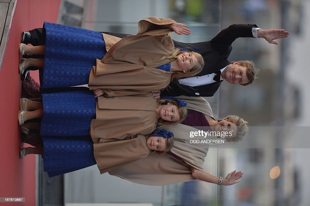 Queen Maxima of the Netherlands (up L) and King Willem-Alexander of the Netherlands pose with their daughters prior to step on a boat on April 30, 2013 to take part in a water pageant on the river IJ in Amsterdam on the day of the new King's investiture