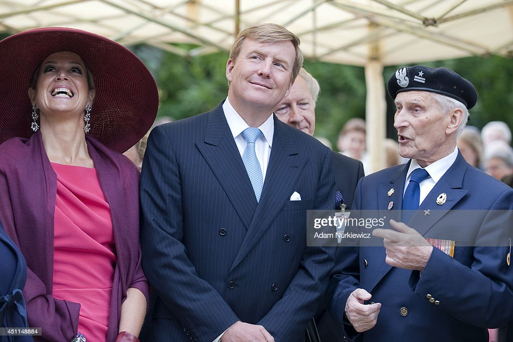 Queen Maxima of The Netherlands and King Willem-Alexander of the Netherlands (C) visit the monument of Polish World War II veteran General Stanislav Maczek as part of their trip to Poland on June 24, 2014 in Warsaw, Poland.