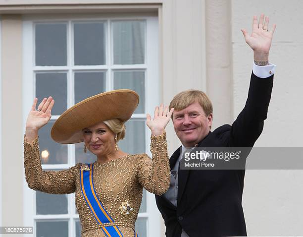 Queen Maxima of The Netherlands and King WillemAlexander of The Netherlands wave from the balcony of the Noordeinde Palace during celebrations for...