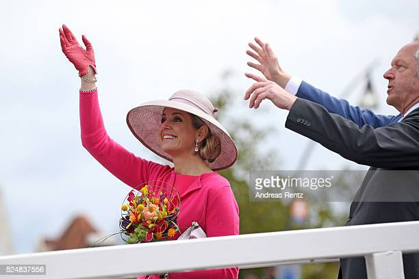 Queen Maxima of The Netherlands and Pieter van Vollenhoven wave to the crowd during King's Day the celebration of the birthday of the Dutch King on...