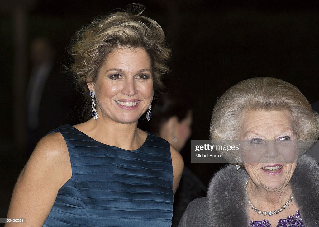 Queen Maxima of The Netherlands and Princess Beatrix of The Netherlands leave after attending a celebration of the reign of Princess Beatrix on February 1, 2014 in Rotterdam, Netherlands.