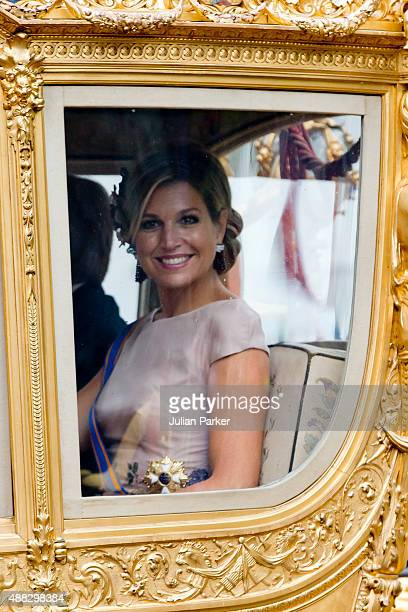 Queen Maxima of The Netherlands arrives back at The Noordeinde Palace in The Golden Carriage during Prinsjesdag on September 15 2015 in The Hague...