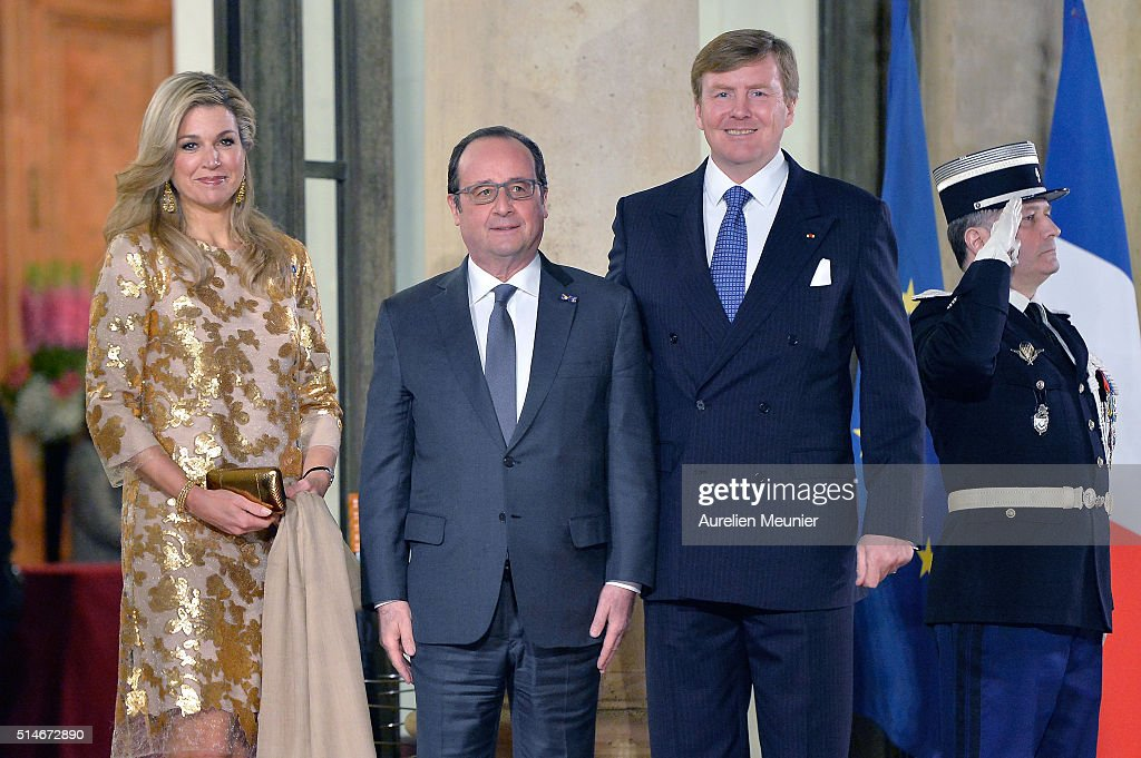 Queen Maxima of The Netherlands, French President Francois Hollande and King Willem-Alexander of The Netherlands pose in front of the Elysee Palace prior The State Dinner in Honor Of King Willem-Alexander of the Netherlands and Queen Maxima at Elysee Palace on March 10, 2016 in Paris, France. Queen Maxima and King Willem-Alexander of The Netherlands are on a two-day state visit in France