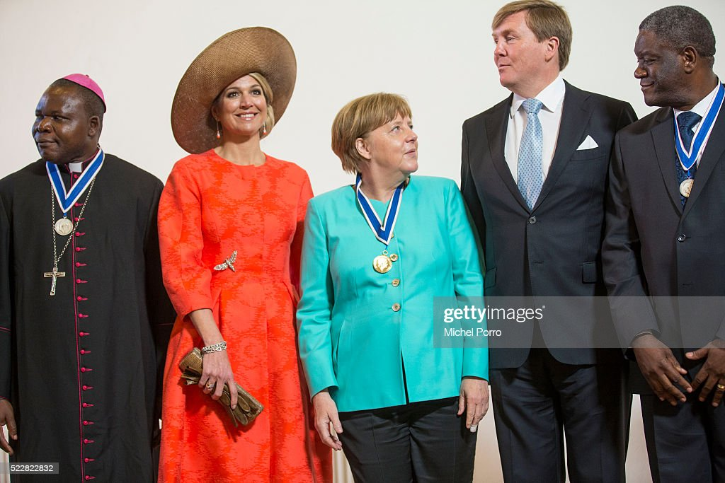 Queen Maxima of The Netherlands, German Chancellor Angela Merkel and King Willem-Alexander of The Netherlands pose with other laureates after the Four Freedoms Awards ceremony on April 21, 2016 in Middelburg, Netherlands.