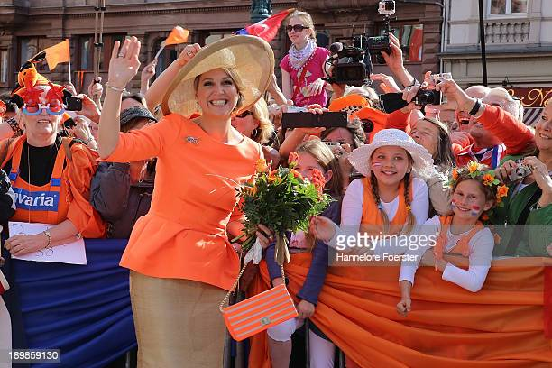 Queen Maxima of The Netherlands greets the crowd as she arrives for a visit to the federal state of Hesse on June 3 2013 in Wiesbaden Germany King...