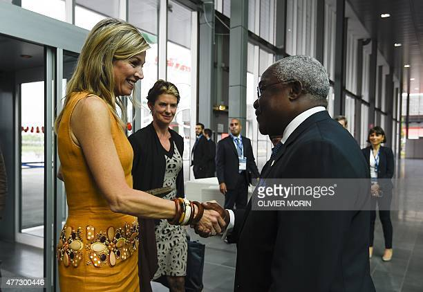 Queen Maxima of the Netherlands is welcomed by IFAD's President Nigeria's Kanayo F Nwanze as she arrives at the Global Forum on Remittances...