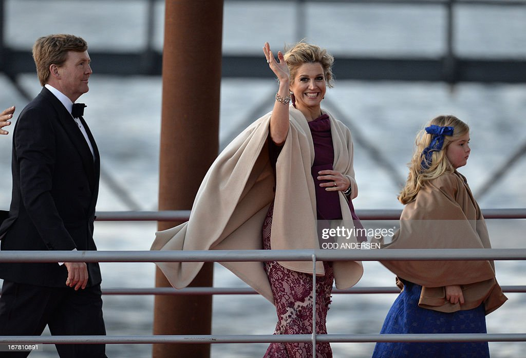 Queen Maxima of the Netherlands (C)King Willem-Alexander of the Netherlands and Catharina-Amalia, Netherlands' Princess of Orange go toward a boat on April 30, 2013 to take part in a water pageant on the river IJ in Amsterdam on the day of the new King's investiture