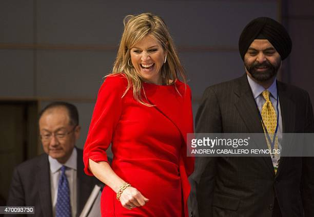 Queen Maxima of the Netherlands laughs as Ajay Banga CEO of Mastercard and Presidnet of the World Bank Group Jim Young Kim look on during a meeting...