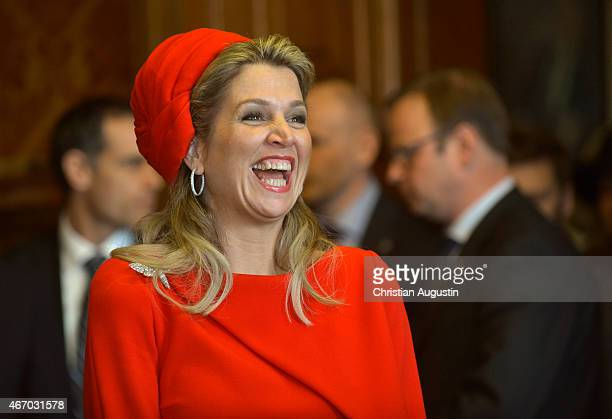 Queen Maxima of The Netherlands laughs during a short statement of King WillemAlexander of The Netherlands at the townhall of Hamburg on March 20...