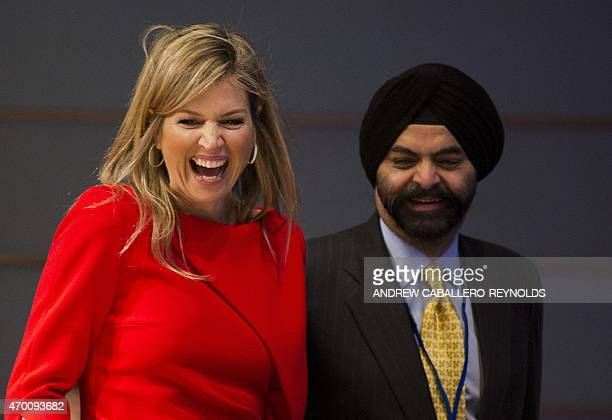 Queen Maxima of the Netherlands laughs next to Ajay Banga CEO of Mastercard during a meeting for 'Universal Financial Access 2020' at the IMF/WB...