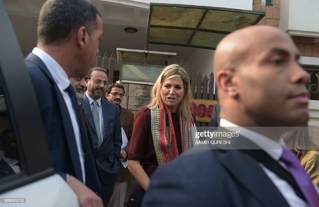 Queen Maxima (C) of the Netherlands leaves the office of the Benazir Income Support Programme (BISP) in Rawalpindi on February 10, 2016. Queen Maxima of the Netherlands, UN Secretary Generals Special Advocate (UNSGSA) for Inclusive Finance for Development, is in Pakistan on a three day official visit. AFP PHOTO / Aamir QURESHI / AFP / AAMIR QURESHI