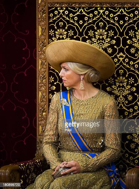 Queen Maxima of The Netherlands listens to King WillemAlexander of The Netherlands as he delivers his first budget speech during celebrations for...