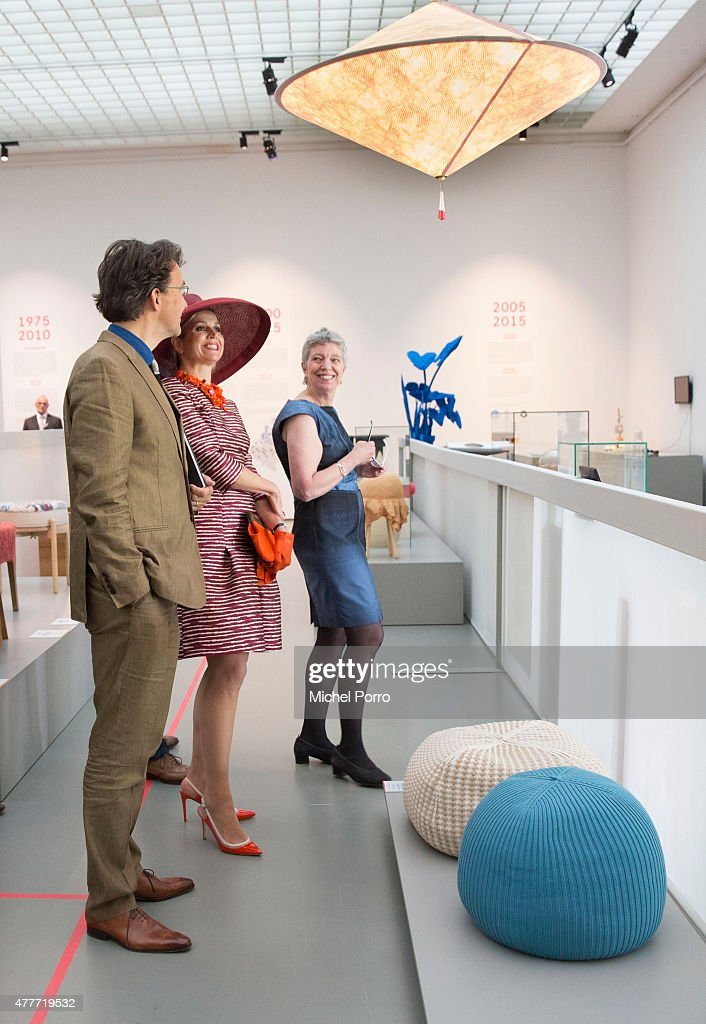 Queen Maxima of The Netherlands looks at a lamp by Wieki Somers while opening the Design Derby Netherlands - Belgium on June 19, 2015 in Rotterdam Netherlands.