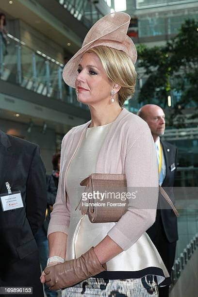 Queen Maxima of The Netherlands looks on during a visit to the Opel factory on June 4 2013 in Ruesselsheim Germany King WillemAlexander of The...