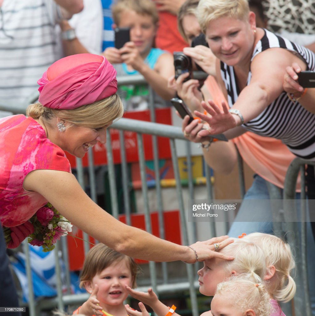 Queen Maxima of The Netherlands makes an official visit to the town centre on June 19, 2013 in 's-Heerenbroek, Netherlands.