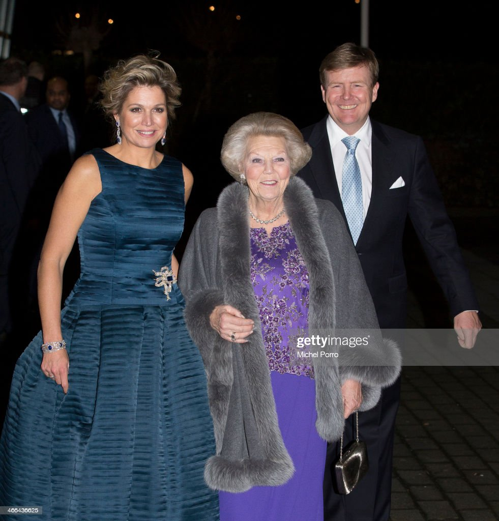 Queen Maxima of The Netherlands, Princess Beatrix of The Netherlands and King Willem-Alexander of The Netherlands leave after attending a celebration of the reign of Princess Beatrix on February 1, 2014 in Rotterdam, Netherlands.