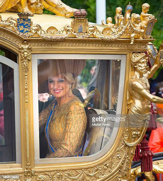 Queen Maxima of The Netherlands rides in the Golden Chariot during celebrations for Prinsjesdag on September 17 2013 in The Hague Netherlands