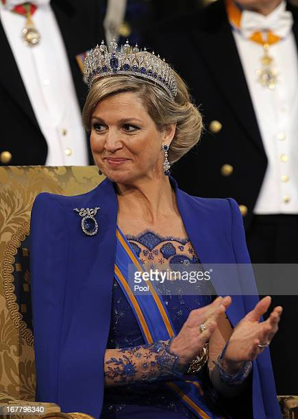 Queen Maxima of the Netherlands sits on her throne during the inauguration ceremony of HM King Willem Alexander of the Netherlands at New Church on...