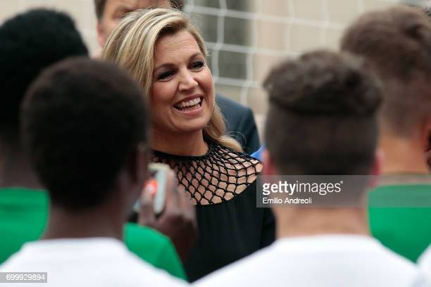 Queen Maxima of the Netherlands smiles during a football clinic for integration organized by Italian Football Federation on June 22 2017 in Milan...