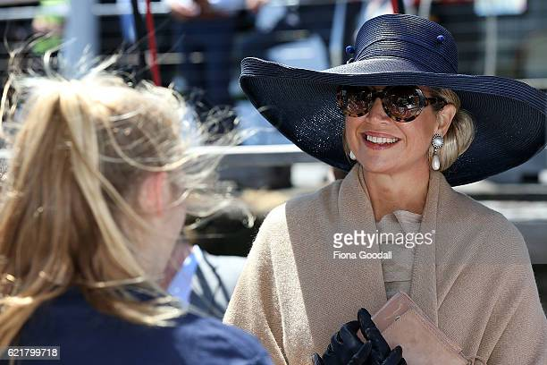 Queen Maxima of The Netherlands speaks to students during her visit to the Spirit of New Zealand Youth Training Vessel at Princes Wharf on November 9...