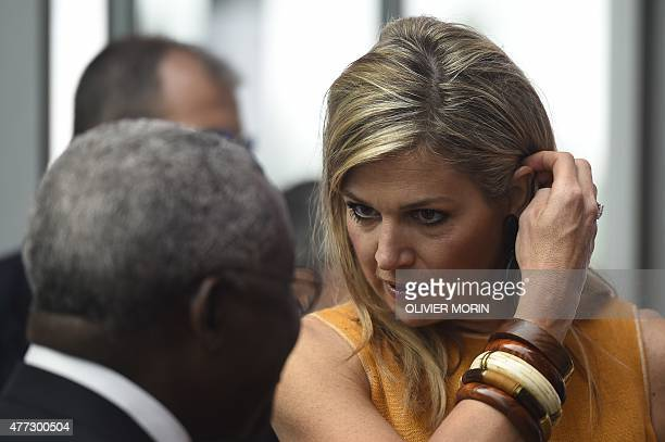 Queen Maxima of the Netherlands talks with IFAD's President Nigeria's Kanayo F Nwanze as she arrives at the Global Forum on Remittances Development...