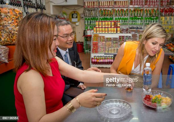 Queen Maxima of the Netherlands visits a grocery store that offers banking services of the Lien Viet Post Bank on May 30 2017 in Da Lat Vietnam The...