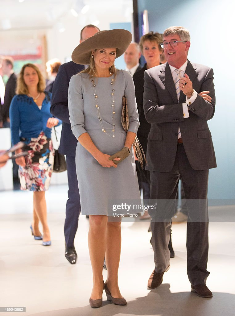 Queen Maxima of The Netherlands walks next to Ton Lansdaal after opening the new visitor center of the Netherlands Bank on September 22, 2015 in Amsterdam, Netherlands