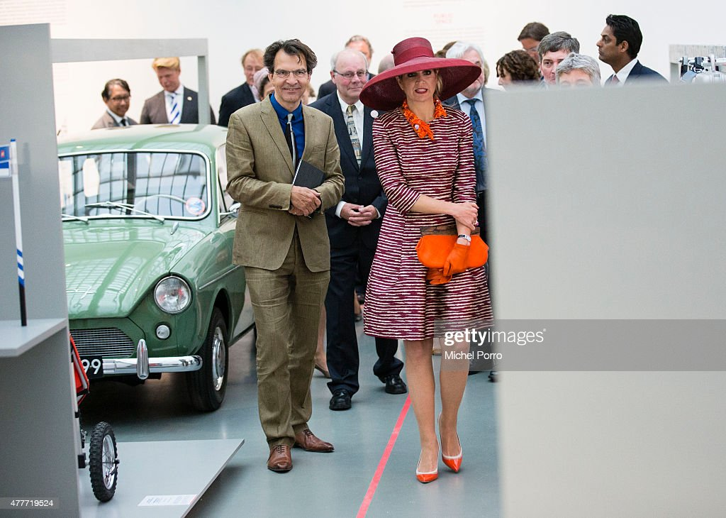 Queen Maxima of The Netherlands walks past a 50s Dutch-designed Daf 33 while opening the Design Derby Netherlands - Belgium on June 19, 2015 in Rotterdam Netherlands.