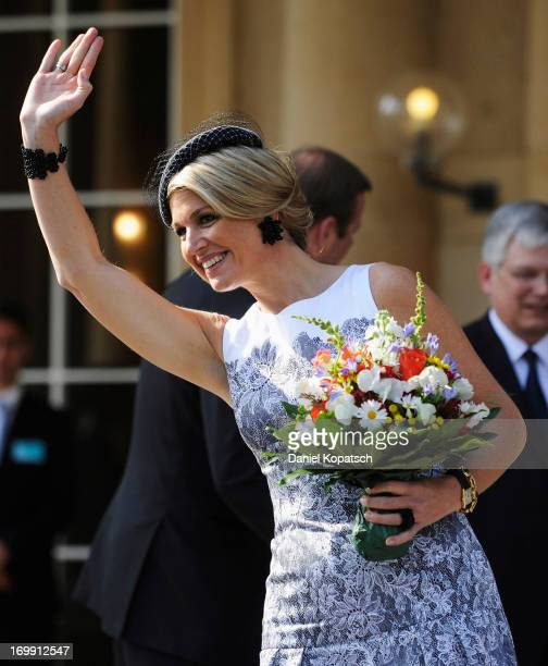 Queen Maxima of the Netherlands waves during a visit in BadenWuerttemberg at the University of Hohenheim on June 4 2013 in Stuttgart Germany