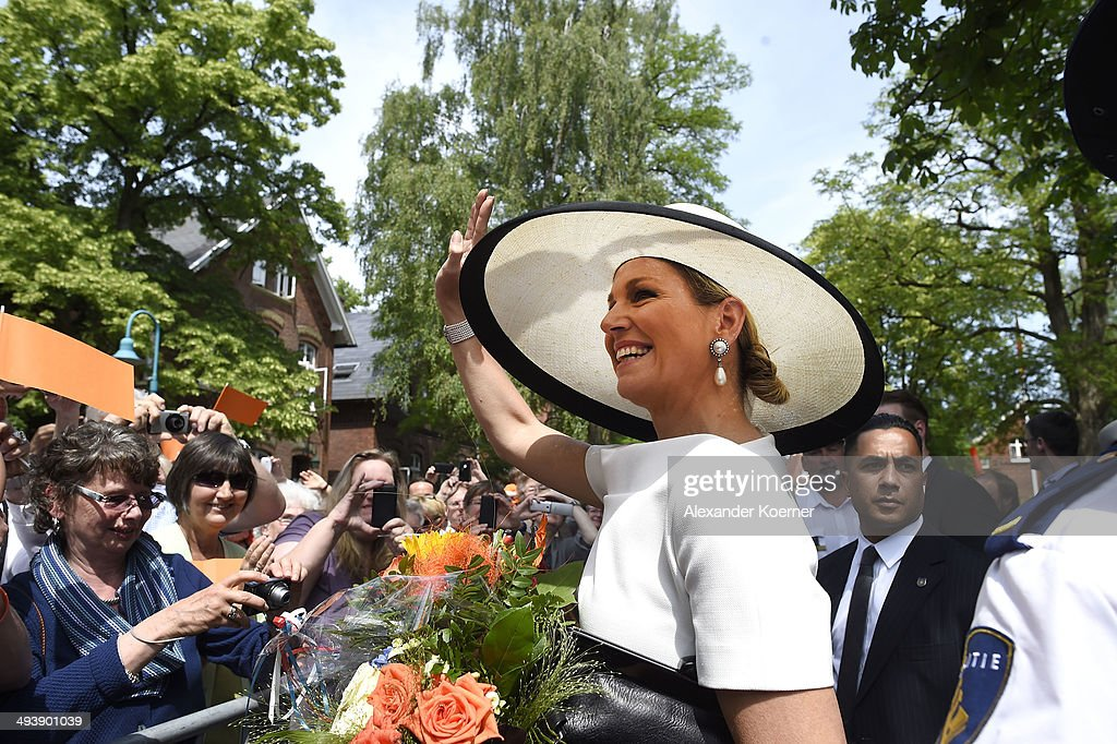 Queen Maxima of the Netherlands waves to the public outside the Marinekompetenz Zentrum Leer on May 26, 2014 in Leer, Germany. The King and the Queen are on a two day journey across the State of Lower Saxony and North Rhine-Westphalia of Germany.