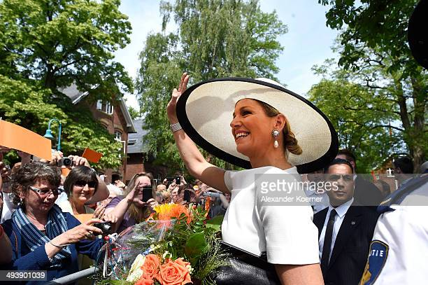 Queen Maxima of the Netherlands waves to the public outside the Marinekompetenz Zentrum Leer on May 26 2014 in Leer Germany The King and the Queen...