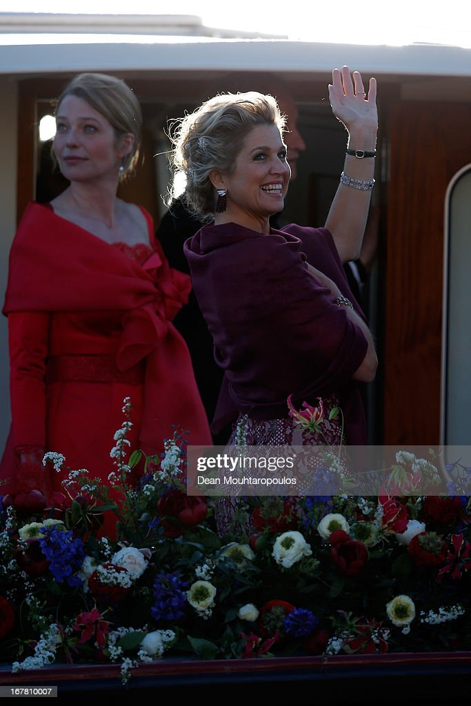 Queen Maxima waves to the crowd along the bank aboard the King's boat for the water pageant to celebrate the inauguration of King Willem of the Netherlands after the abdication of his mother Queen Beatrix of the Netherlands on April 30, 2013 in Amsterdam, Netherlands.