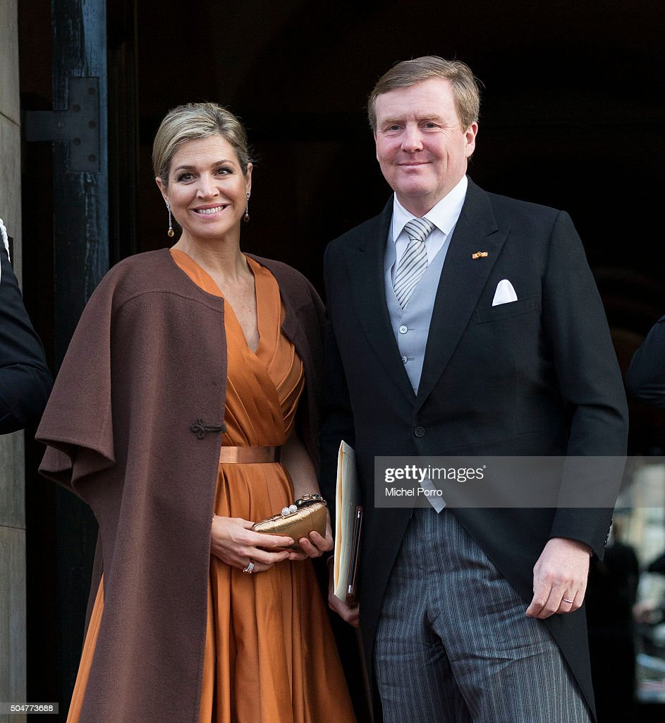 Queen Maxima, wearing a dress by Dutch designer Mattijs van Bergen and a brown cape of Princess Beatrix and <a gi-track='captionPersonalityLinkClicked' href=/galleries/search?phrase=King+Willem-Alexander&family=editorial&specificpeople=160214 ng-click='$event.stopPropagation()'>King Willem-Alexander</a> of The Netherlands arrive to attend the New Year's reception for the diplomatic corps at the Royal Palace on January 13, 2015 in Amsterdam, Netherlands.