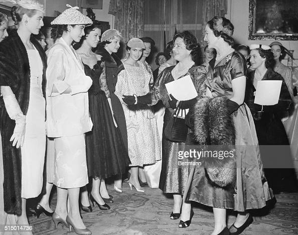 Queen Mother Elizabeth and Daughter Examining Models' Clothing ...