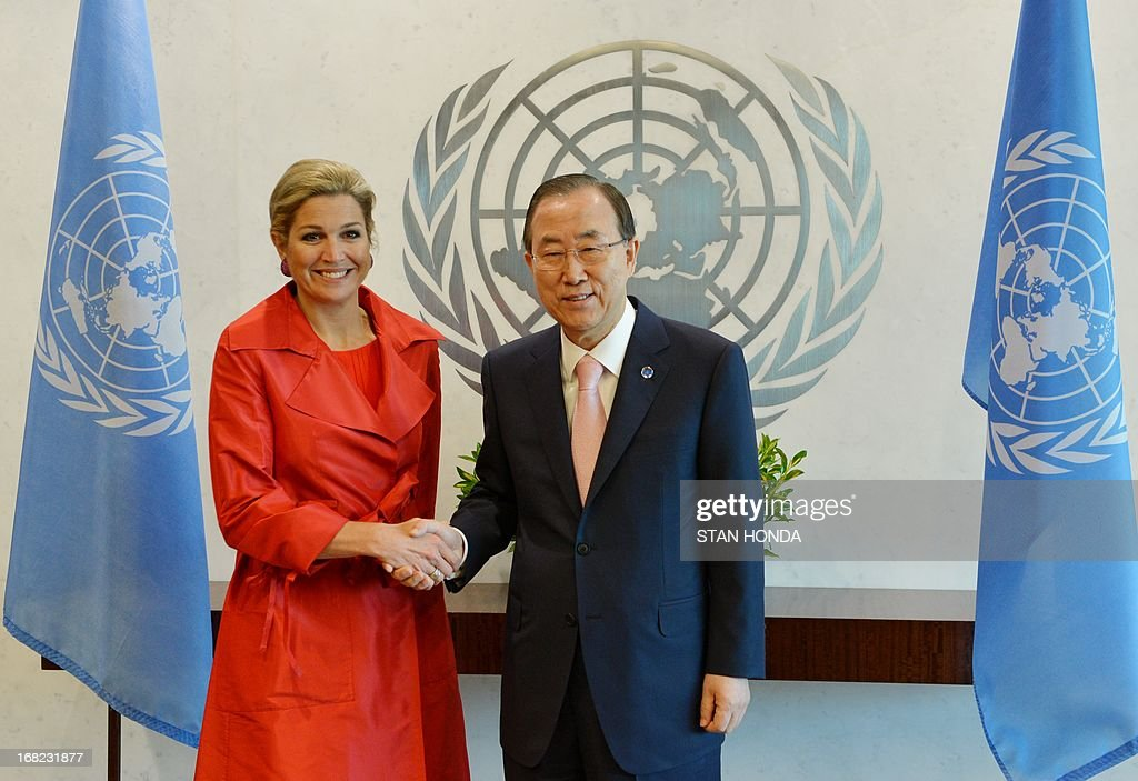 Queen Máxima (L) of the Netherlands shakes hands with United Nations Secretary General Ban Ki-Moon on May 7, 2013 before their meeting at UN headquarters in New York. AFP PHOTO/Stan HONDA