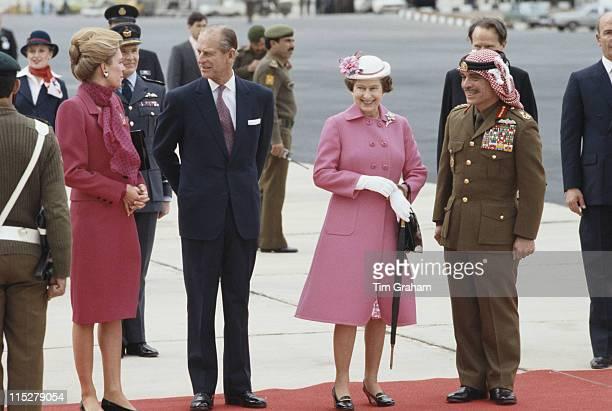 Queen Noor of Jordan Prince Philip Queen Elizabeth II and King Hussein of Jordan following the British Royals' arrival at Amman Military Airport for...