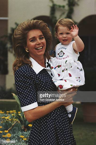 Queen Noor of Jordan with her youngest daughter Princess Raiyah bint Al Hussein in Jordan circa 1987