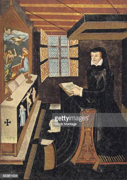Queen of France Catherine de Medici wife of King Henry II and daughter of Lorenzo de Medici in mourning clothes kneels at her priedieu and reads the...