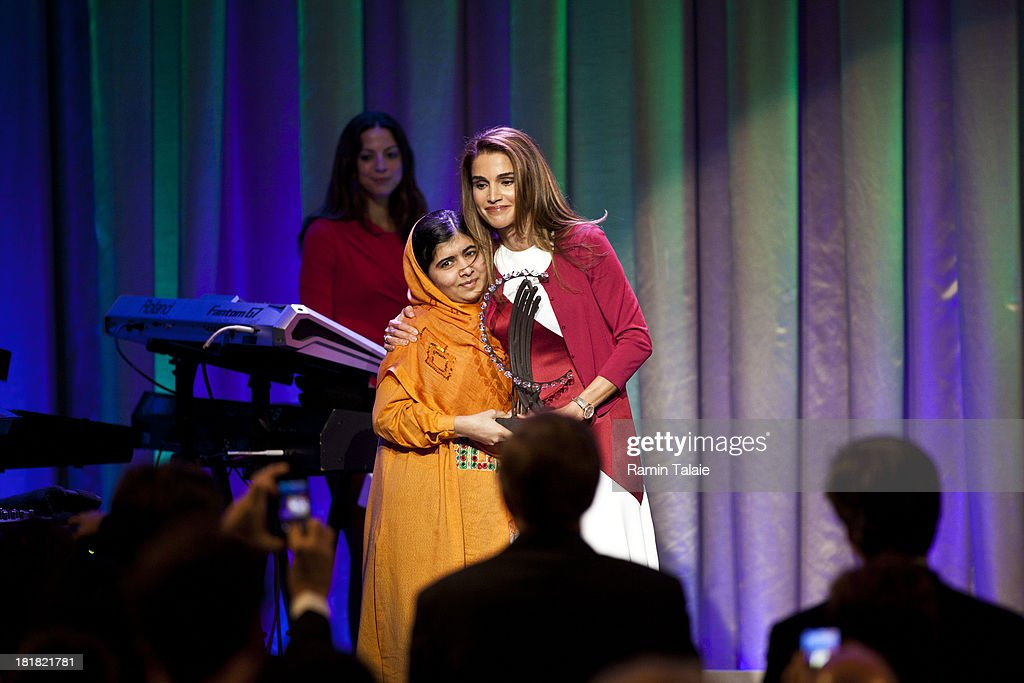 Queen of Jordan, Rania Al Abdullah (R), awards The Leadership in Civil Society to Malala Yousafzai, at the Clinton Global Citizen Award ceremony on September 25, 2013 in New York City. Timed to coincide with the United Nations General Assembly, CGI brings together heads of state, CEOs, philanthropists and others to help find solutions to the world's major problems.
