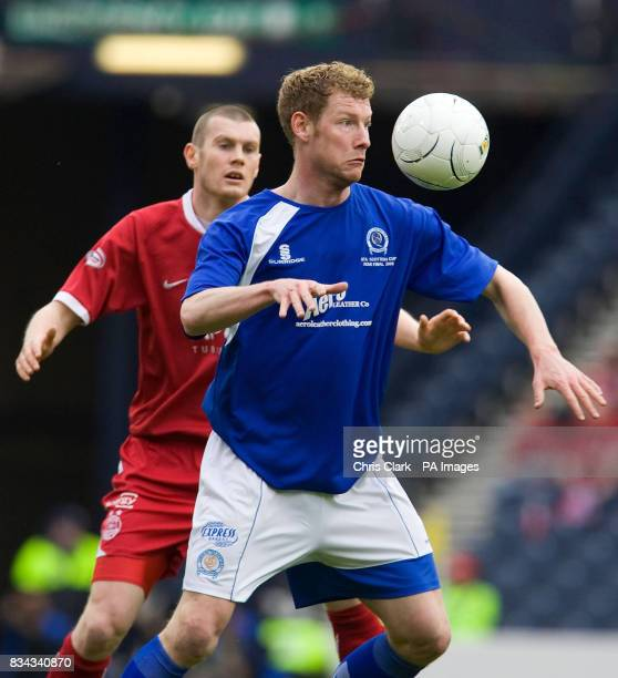 Queen of the South's Sean O'Connor shields the ball from Aberdeen's Zander Diamond during the Scottish Cup Semi Final match at Hampden Park Glasgow