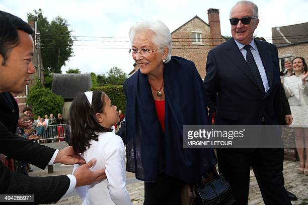 Queen Paola and King Albert II of Belgium arrive for the first communion of their grandchildren at the SainteCatherine church in Bonlez on May 29...