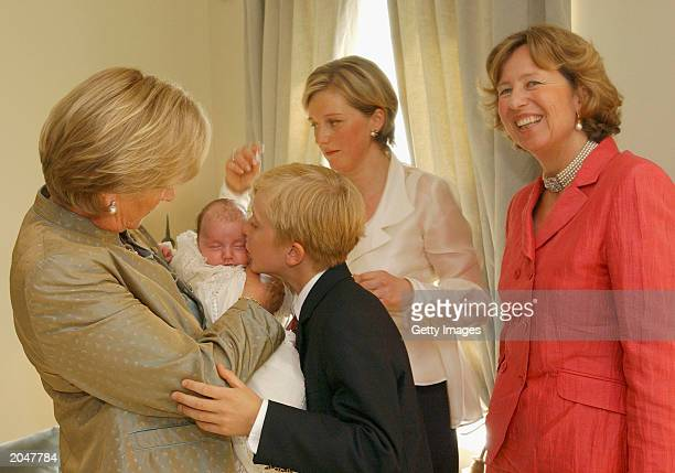 Queen Paola holds princess laetitia Maria Prince Joachim Princess Astrid and Nora from Lichtenstein on June 1 2003 in Brussels Belgium Members of the...
