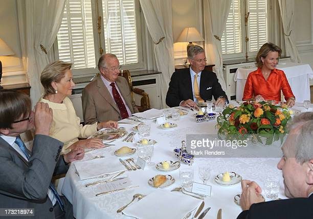 Queen Paola King Albert II Prince Philippe and Princess Mathilde of belgium meet former Prime Ministers of Belgium at Laeken Castle on July 10 2013...