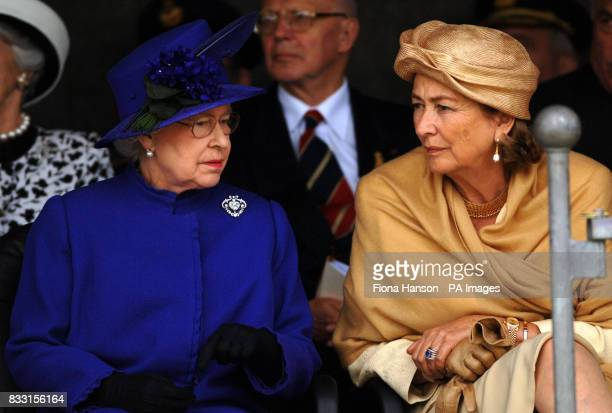 Queen Paola of Belgium and Britain's Queen Elizabeth II are seen at the Tyne Cot War Cemetary Passchendaele during a ceremony for WWI Commonwealth...