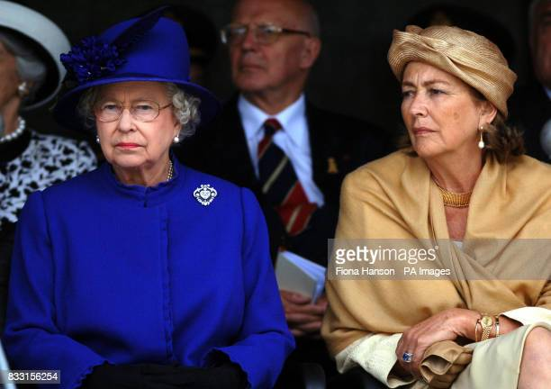 Queen Paola of Belgium and Britain's Queen Elizabeth II at the Tyne Cot War Cemetary Passchedaele during a ceremony for WWI Commonwealth soldiers