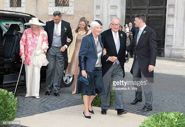 Queen Paola of Belgium and King Albert of Belgium and Archduchess Margherita of Belgium arrive at the wedding of Prince Amedeo of Belgium and...